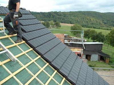 Umbau eines alten Dachstuhls mit Gaube und neuen Ziegeln VI